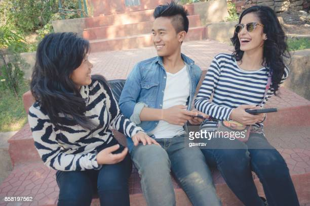 Multiethnic happy, college friends gossiping and having fun together.