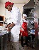 Multi-ethnic male chefs preparing food