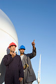 Multi-ethnic male construction workers pointing