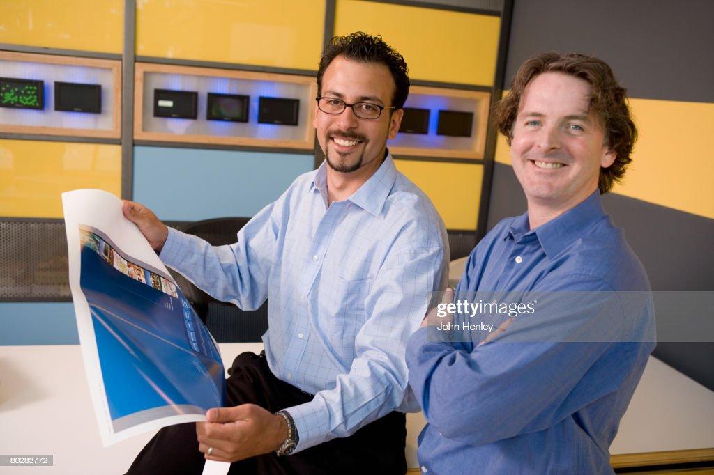 Multi-ethnic male graphic designers in office : Stock Photo