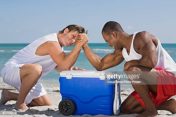 Multi-ethnic men arm wrestling
