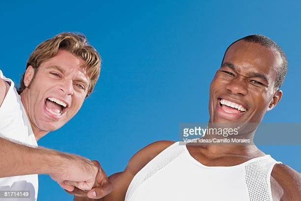 Multi-ethnic men laughing