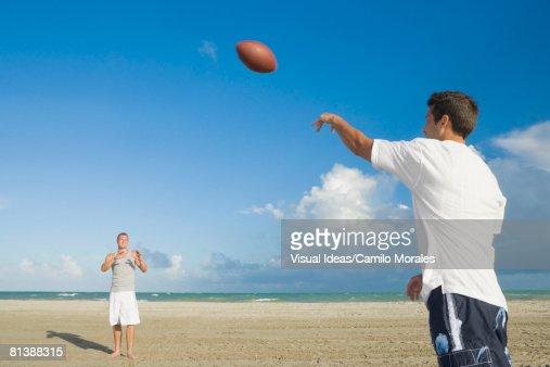 Multi-ethnic men playing catch