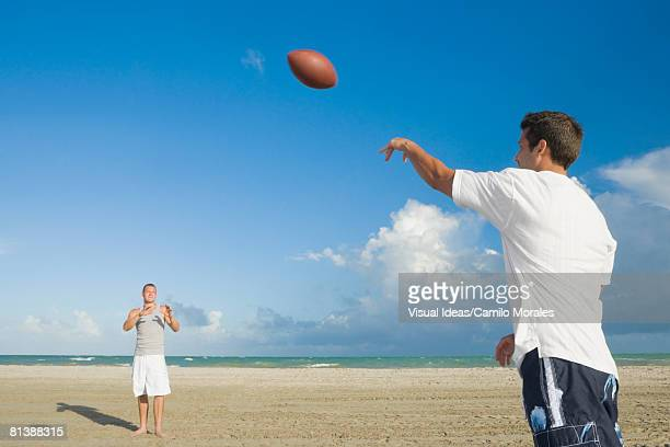 Multi-ethnic men playing catch