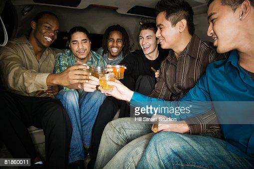 Multi-ethnic men toasting with drinks