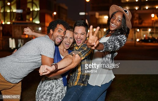 Multi-ethnic millenial group of friends taking a selfie photo : Stock Photo
