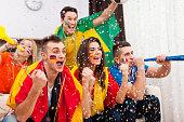 Multi-ethnic people celebrates win of favourite football team