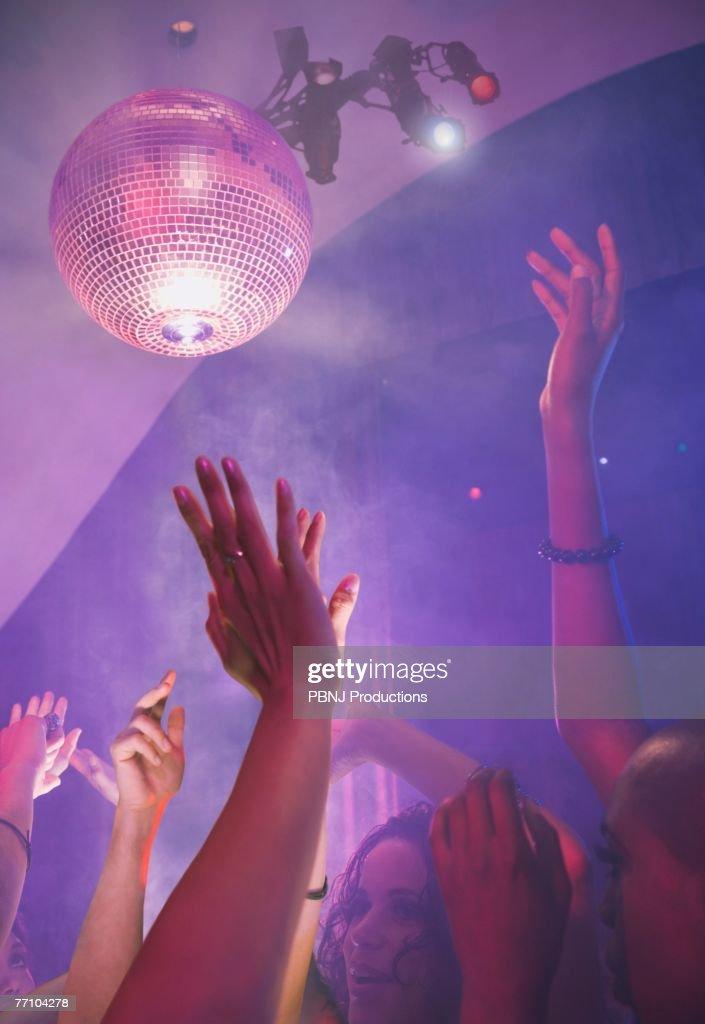 Multi-ethnic people dancing at nightclub