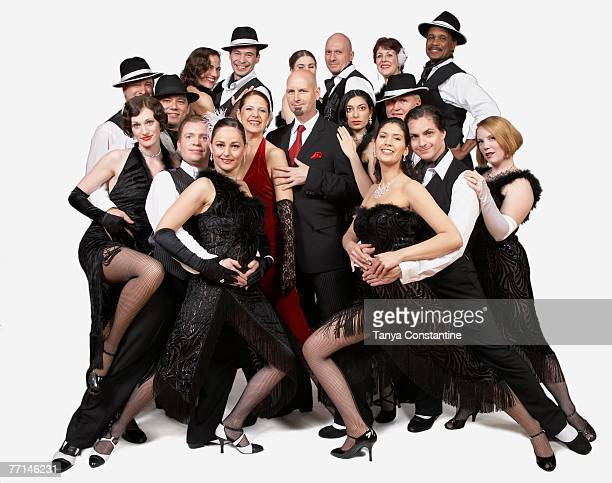 Multi-ethnic people posing in tango outfits