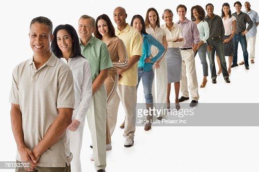 Multi-ethnic people standing in line : Stock Photo