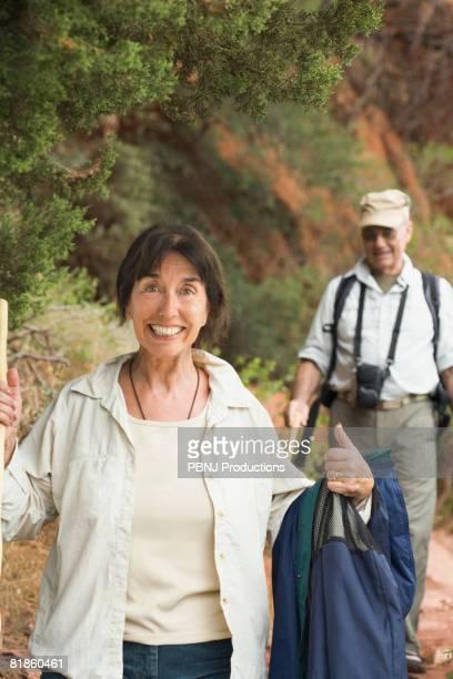 Multi-ethnic senior couple hiking
