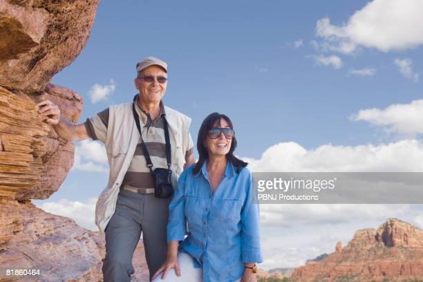 Multi-ethnic senior couple next to rocks