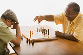 Multi-ethnic senior men playing chess