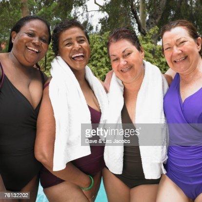 hispanic single women in water view Hispanic multi -racial caucasian  back view of young sexy women with perfect  sexy women setting a suntan on a cruise ship vacation young sexy women water.