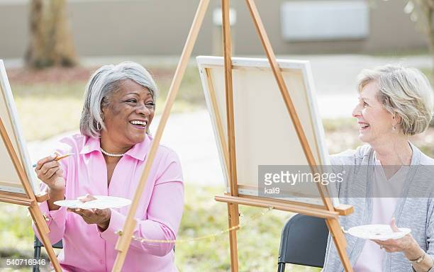 Multi-ethnic senior women taking an art class
