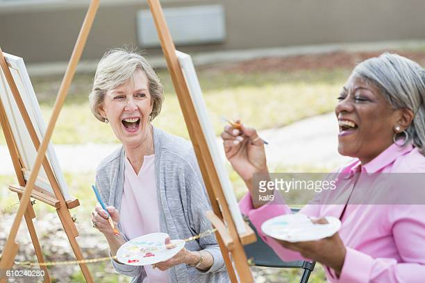 Multi-ethnic senior women taking an art class