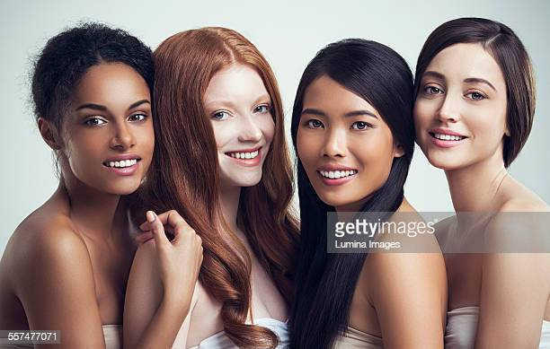 Multi-ethnic smiling women posing together