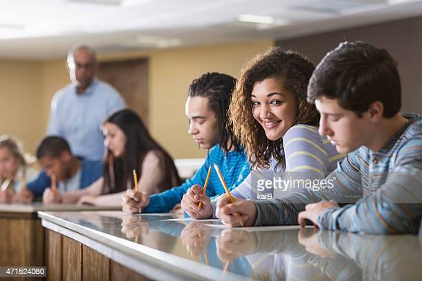 Multi-ethnic students taking an exam