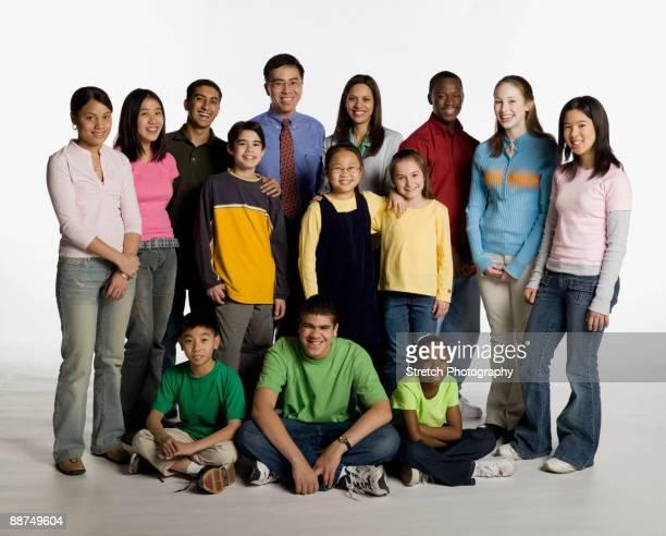 Multi-ethnic teacher and students posing