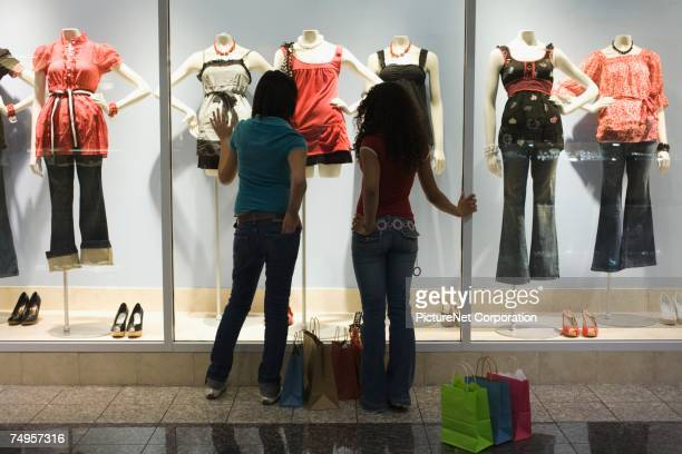 Multi-ethnic teenage girls window shopping