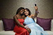 Multi-ethnic teenaged girls taking own photograph