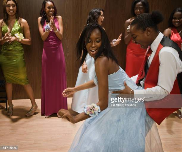 Multi-ethnic teenagers dancing at prom