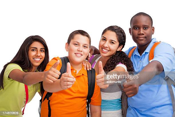 Multi-ethnic teenagers making thumbs up