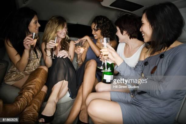 Multi-ethnic women celebrating engagement