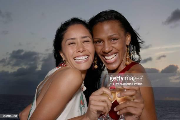 Multi-ethnic women holding drinks
