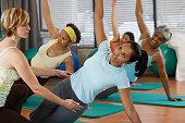 Multi-ethnic women in yoga class
