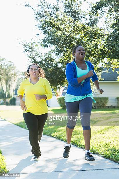 Multi-ethnic women jogging or power-walking together