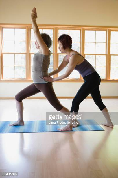 Multi-ethnic women practicing yoga
