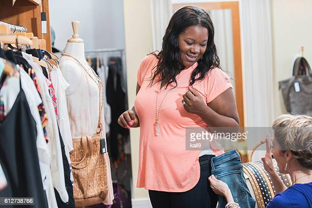 Multi-ethnic women shopping in clothing store
