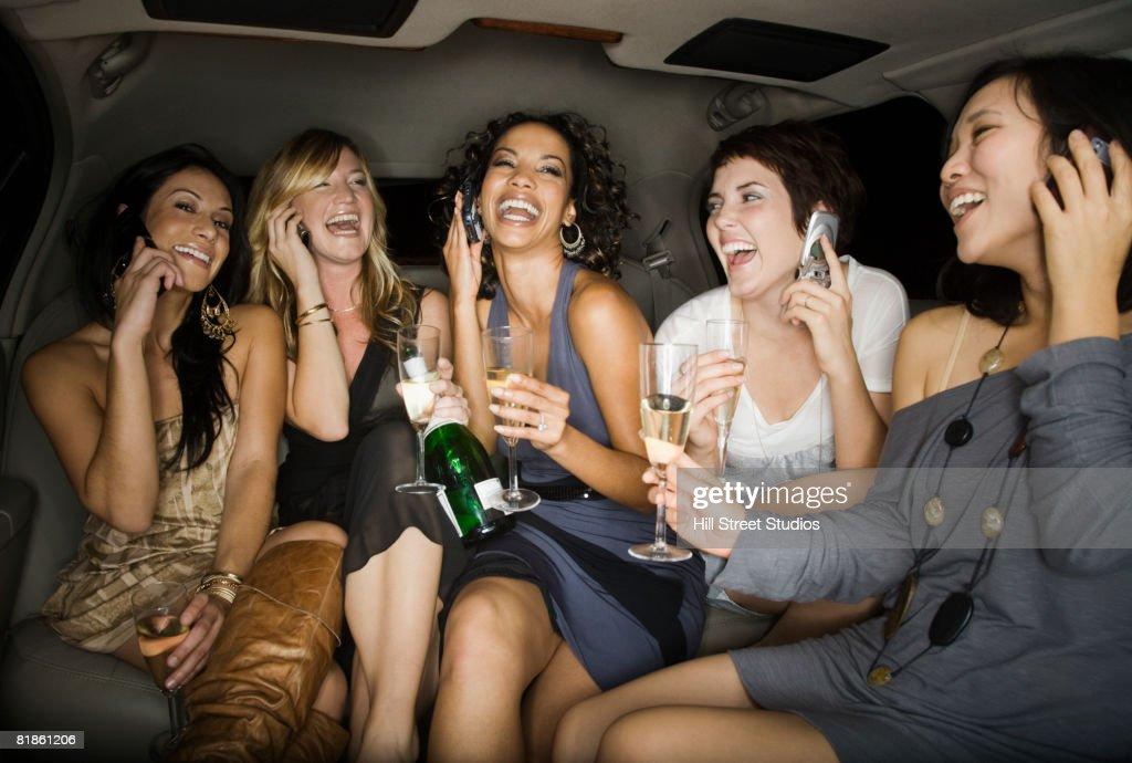 Multi-ethnic women talking on cell phones : Stock Photo