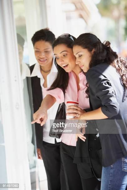 Multi-ethnic women window shopping