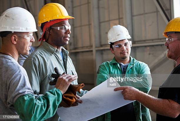 Multi-ethnic workers discussing plans.