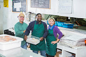 Multi-ethnic workers in seafood store