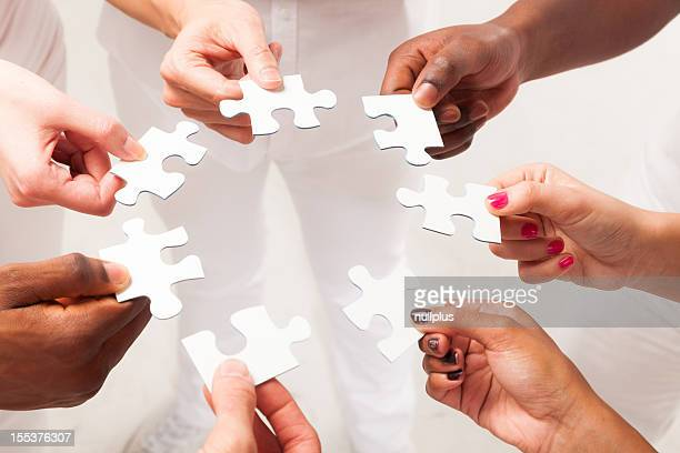 multi-ethnic young adults' hands