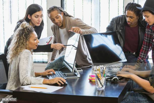 Multi-ethnic young creatives in a business meeting
