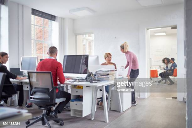Multi-ethnic young people working in a office