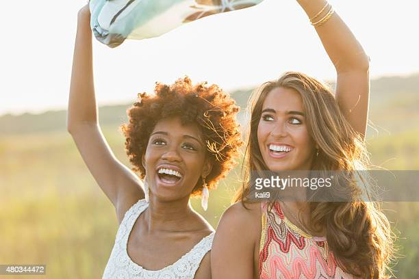 Multi-ethnic young women enjoying nature on summer day