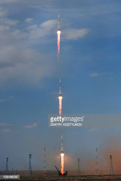 A multiexposure image shows the Russian Soyuz TMA15 rocket carrying Canadian astronaut Robert Thirsk European Space Agency astronaut Frank De Winne...