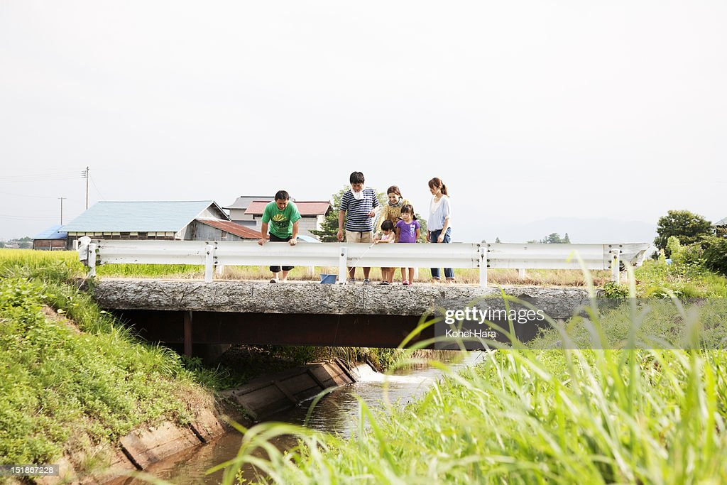 multifamilies enjoy fishing in the country : Stock Photo