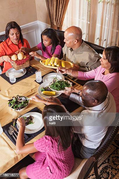 Multi-generation African American family at dinner table