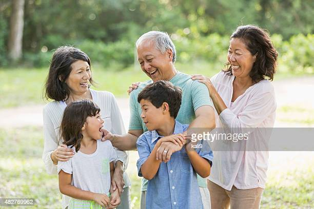 Multi-generation Asian family in the park