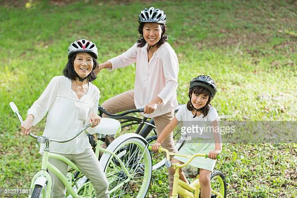 Multi-generation Asian family, riding bikes