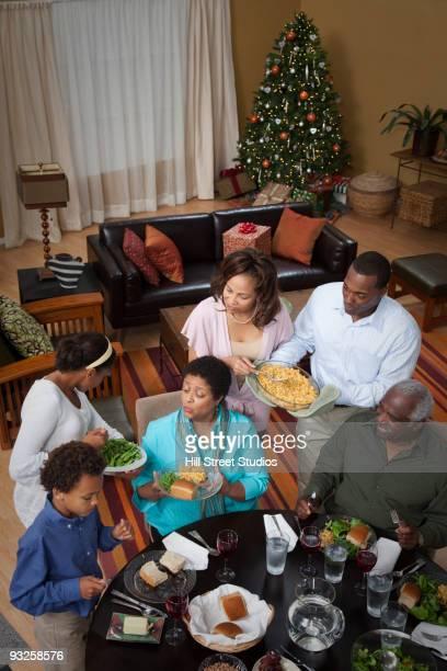 Multi-generation family eating Christmas dinner