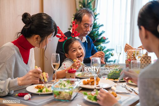 Multigeneration Family Eating Christmas Dinner Together Stock