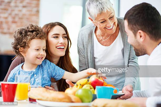 Multi-generation family eating fruits