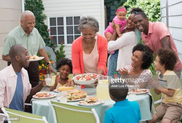 Multi-generation family enjoying backyard barbecue